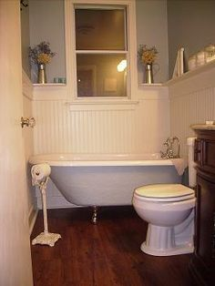 What's not to love? Beadboard wainstcot with shelf, Allure Trafficmaster vinyl plank flooring, soft blue-gray walls (love the tub too, but that won't be upgraded any time soon).