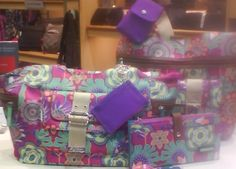 Lily Bloom handbags. Made from recycled plastic bottles. I LOVE mine!