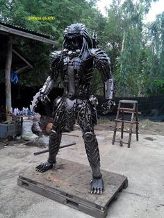 predator statue, life size, scrap metal art from thailand