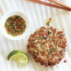 The key to a good tuna burger is to avoid overprocessing and overcooking. Cook them on the stovetop so you have better heat control and can ensure that they stay a nice, moist medium rare inside. Serve with the Thai-Style Dipping Sauce.