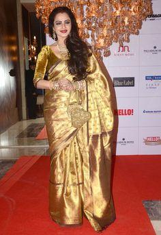 Rekha bleeds elegance in her golden saree