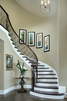 front foyer- needs a better picture display on the stairs wall, maybe not so uniform looking