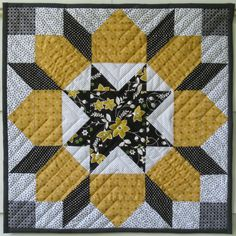 Swoon Block - I really like the use of patterned fabric for the middle and solids surrounding it!