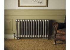 Gorgeous radiator (Duchess Painted in Stock Sparkly Silver) plus I love the panelling and the colour.