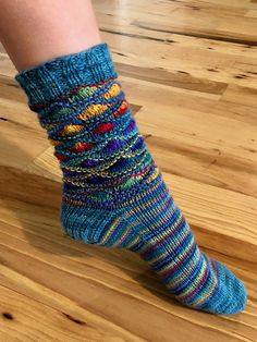 """""""Hope Gallery Graffiti Socks"""" is the first pattern released from Lollyfii's ATX Hometown series. This ongoing series' designs are inspired by Lollyfii's hometown of Austin TX."""