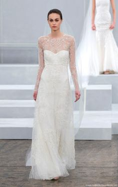 Monique Lhuillier  ivory long sleeve floral lattice A-line wedding dress with an illusion high neckline and sweetheart bodice, pale gold lace-up
