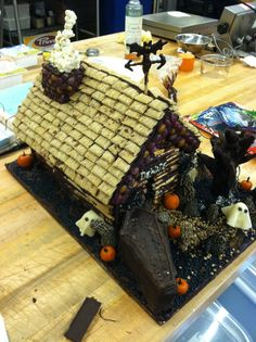Halloween gingerbread house- @Dani Weinman check the thatched roof