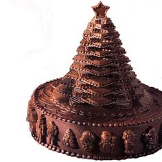 Chocolate Christmas Tree Cake - For those who really, really love chocolate! Our fudge iced cake is  decorated with molded candies in holiday designs, then topped  by an all- candy tree.