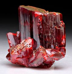 Realgar aka ruby sulfite has a mohs hardness of 1.5-2, similar to that of talc or gypsum (diamonds are a 10)--so not ideal for jewelry, but beautiful to display