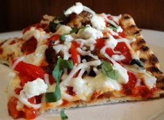 GRILLED GOAT CHEESE, CARAMELIZED ONION,  ROASTED RED PEPPER, & ITALIAN SAUSAGE PIZZA