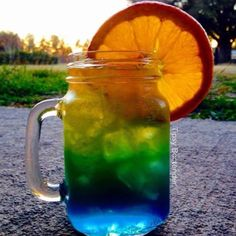 Start your night of right with our Florida Sunset Cocktail! Our Florida Sunset Cocktail is made with Blue Curacao, Mango Rum, Sparkling ICE Orange Mango! Candy Drinks, Juice Drinks, Drinks Alcohol Recipes, Non Alcoholic Drinks, Cocktail Drinks, Fun Drinks, Drink Recipes, Tipsy Bartender, Mango Rum