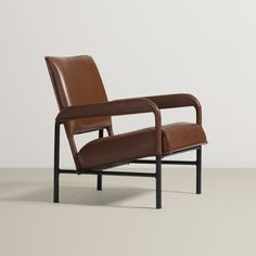 Jacques Adnet; Leather, Enameled Steel and Brass Armchair from the S.S. Île de France, c1950.