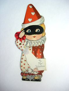 Vintage Die Cut Out Clown Doll Valentine Mechanical Greeting Card of a Stand Up Little Girl with Black Mask. $60.00, via Etsy.