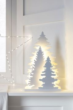 Channel the natural beauty of Aspen's forests with our magical wooden light Christmas decoration. Three layered cut out detail conifer trees stand tall, backlit with a wonderful warm white glow. These pretty pieces sit pretty on windowsills and mantelpieces alike.