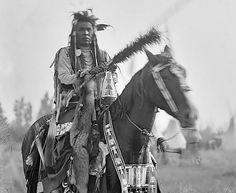 Crow man on horseback - ceremonial dress