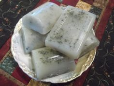 Rosemary-Lavender Soap  3 cups of shredded glycerin soap base  1/4 cup of distilled water  1 1/2 tsp. rosemary oil  1/2 tsp. lavender oil   1 tsp. pulverized dried rosemary   Mix the glycerin and water in a bowl and heat in microwave at 20 second intervals until melted..   Add oils and herbs and mix..   Place in soap molds..