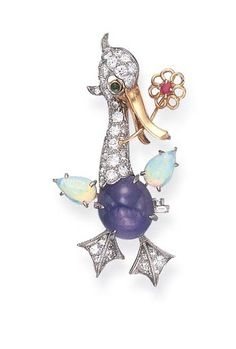 A GEM-SET BROOCH, BY CARTIER