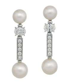 PAIR OF DIAMOND AND PEARL EARRINGS, BULGARI      Each 8.00mm cultured pearl surmount set above an oval cut diamond supporting an articulated 9.00mm cultured pearl drop and round brilliant cut diamond set baton connector, the diamonds together weighing approximately 1.62 carats, mounted in 18ct white gold, signed BVLGARI.