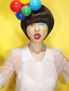 Karen O.'s quirky and colorful style. red lipstick, bob haircut, vidal sassoon style, ball fascinator
