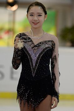 Da Bin Choi of Korea poses during the junior ladies free skating medal ceremony of ISU Junior Grand Prix of figure skating on September 11, 2015 in Linz, Austria