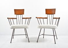 A wonderful pair of vintage mid-century ash and wrought iron side chairs by designer Richard McCarthy for Selkirk furniture, featuring curved ash bar and arms supported by a simple iron spindle gal...