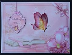 Book of Butterflies by Sue Soules I printed the sheet onto satin photo paper. Cut out the main picture and attached it to a white card blank. The corner decoupage and sentiment were added using foam pads. The butterfly wings were glued at the body and the wings raised.