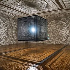 anila quayyum agha's 'intersections' casts a delicate web of shadows with a single light bulb.  see more on #designboom #artinstallation #anilaquayyumagha by designboom