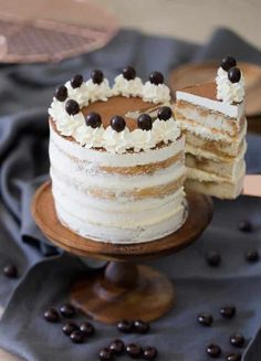 This fluffy moist Tiramisu cake is soaked with a coffee and brandy, stacked with a mascarpone custard and covered in a Swiss buttercream. Cupcakes, Cake Cookies, Cupcake Cakes, Easy Tiramisu Recipe, Tiramisu Cake, Köstliche Desserts, Delicious Desserts, Italian Desserts, Baking Recipes