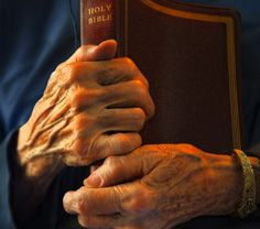 10242589-enduring-comfort-89-year-old-hands-holding-bible 2