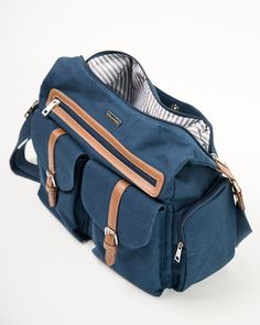 - Description - Product Details - Material and Care Don't sacrifice style for function. Our versatile Rambler Satchel is the perfect organizer bag to keep your essentials stylishly stowed and well ord