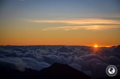 The sun right as it comes over the clouds. View from Mount Haleakala, Maui