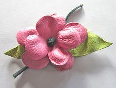 Painted leather flower how-to. These would be cute without being painted!