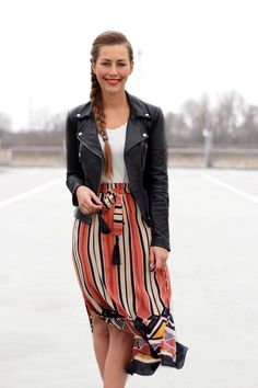 Alexa from @FabesFashion showcases our stripped skirt with matching black leather pieces.   H&M OOTD