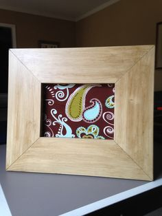 Frame I antiqued with fabric covering cork board