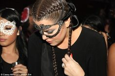 A stunning sight: The 30-year-old star dazzled thanks to her eye-catching bejewelled mask, appropriate for the lavish masquerade themed bash