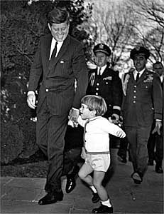 John F. Kennedy and his son, John Jr., leave Arlington cemetery after a ceremony on November 18, 1963.