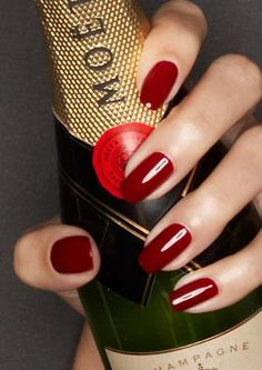 Red Nails and Champagne. Nice combination.
