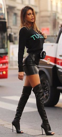 #fall #outfits women's black printed crew-neck long-sleeve shirt and black leather mini skirt with black leather knee high boots outfit #kneehighbootsoutfit