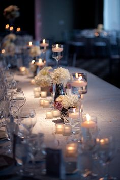 like the mix of floating candles and small arrangements for a long table