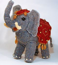 Vera Orlova is talented bead artist from Russia. She makes amazing beaded design accessories and toys. Every piece is very original and unique.