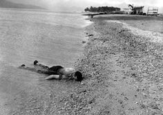 A sailor killed by the Japanese air attack washes ashore at Naval Air Station, Kanoehe Bay.