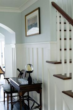 Coastal Home - Seaside Home - Entry - Custom Millwork - Board and Batten - High Chair Rail - Caneback Chair - Side Table - Nautical Art - Blue - Green - White #ChairRail