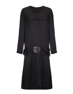 1920s Black satin long sleeved and loose fitting flapperdress with classic dropped waist and knee length skirt. This dress features lots of lovely detailswith applique leaves down the centre back, wide belt and intricate buckle.