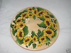 Its finally here for all you sunflower lovers. A beautiful hand painted lazy susan designed and painted by me. If you are a sunflower person you cannot pass this up.!    This lazy susan is 15 1/2 inches in diameter and hosts a garden of sunflowers. Its beautiful, its practical and it can be yours! The sunflowers are painted in hues of gold and yellow, the leaves are shades of green. the picture really doesnt do it justice.    This wont be around for long and with the holidays coming it c...