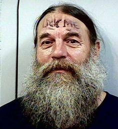 "Oregonian Lance McKenzie, 49, served a 60-day sentence for assault. It is unclear whether ""Lick Me"" on his forehead is a real tattoo or written with marker pen. For his sake, let's hope it's the latter."