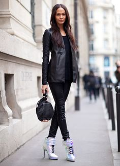 Joan Smalls. love that she wore those boots straight from the runway!
