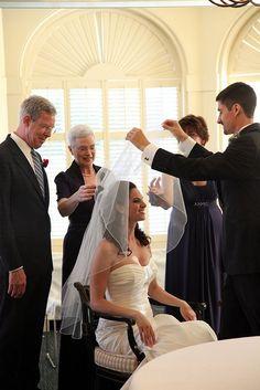 In the Bedekken ceremony, the groom puts the veil over his bride.  http://www.aroundtheworldl.com