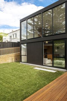 Architecture Modern Black Cube House Design With Glass Wall And Green Lawn Garden Also Wooden Deck Path Cube House with Glass Walls to Enjoy Scenery