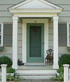Love colors of front door. Small front stoop - Notice wide white trim around front door. Can be with/without porch overhang roof. Use for colonial or cape cod with square columns. Cottage Front Doors, House Front Door, House With Porch, Front Porch Without Roof, Colonial Front Door, Cottage Porch, House Entrance, Front Door Overhang, Front Stoop