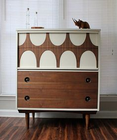 Buffet style dresser with modular sliders that show off white pockets